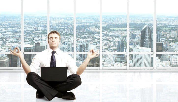 businessman meditation in room with big window