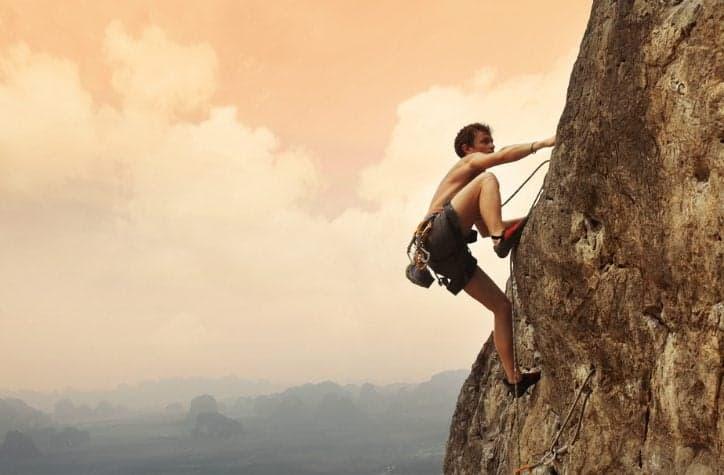 guy climbing rock