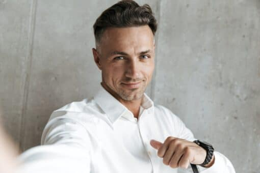 Portrait of a confident man in white shirt